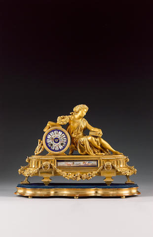 A late 19th century French porcelain mounted gilt metal mantel clock The movement stamped C & S, numbered 11644 4