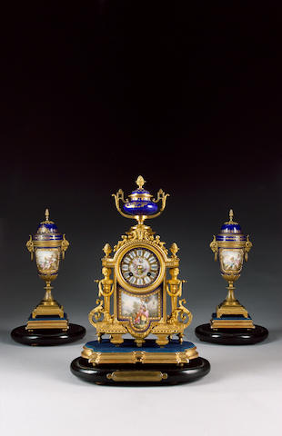 A late 19th century French gilt metal 'jewelled' porcelain mounted clock garniture The movement stamped Japy Freres and B.R.8388 9