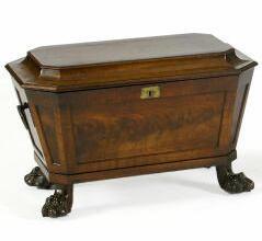 A Regency mahogany cellaret of sarcophagus form,