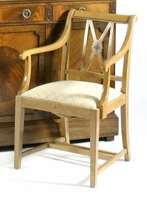 A set of eight beech open armchairs,