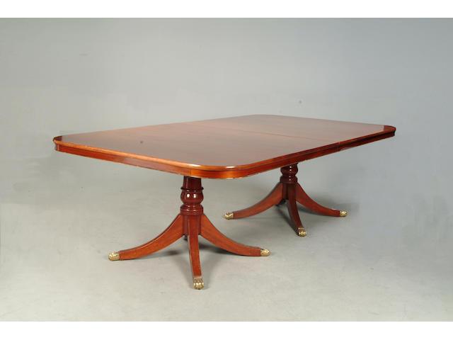 A 20th century mahogany triple pedestal dining table