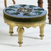 A Victorian giltwood footstool,