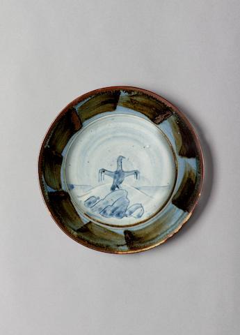 Bernard Leach 'Cormorant drying its wings', a Dish, circa 1958 Diameter 7 7/8in. (20cm)