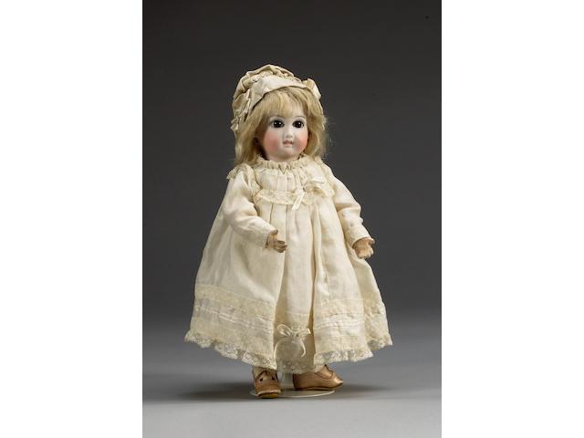 Jumeau 'Almond eye' pressed bisque head doll, circa 1885
