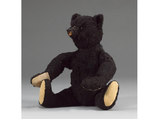 Rare black Steiff Teddy bear, German 1912  This bear was originally given to one of the designers of the Titanic, and has since been passed on through the same family.