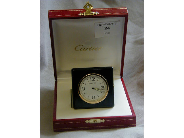 Cartier leather cased travel alarm clock
