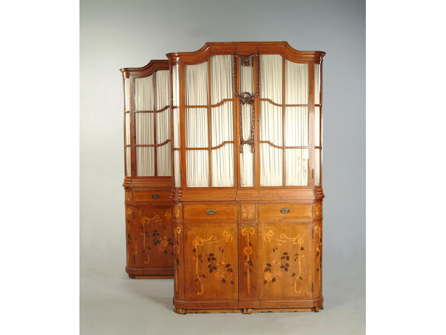 A pair of German early 20th century mahogany, tulipwood and marquetry bookcases