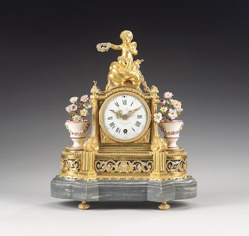 A 19th century French porcelain mounted, ormolu and grey marble mantel timepiece