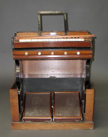 A 19th Century travelling folding organ,