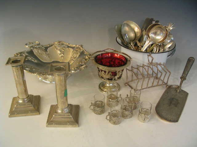 A quantity of silver and plated items to include a pair of silver Candlesticks, together with other metalwares (qty),