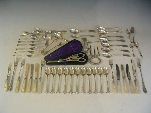 A quantity of silver Flatware to include a set of ten Teaspoons and Sugar Tongs by Walker & Hall Sheffield (qty),