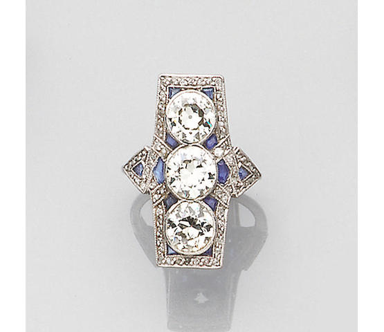 An art deco diamond and synthetic sapphire panel ring