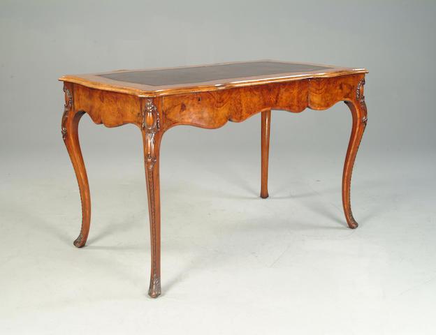A Victorian walnut and inlaid bureau plat