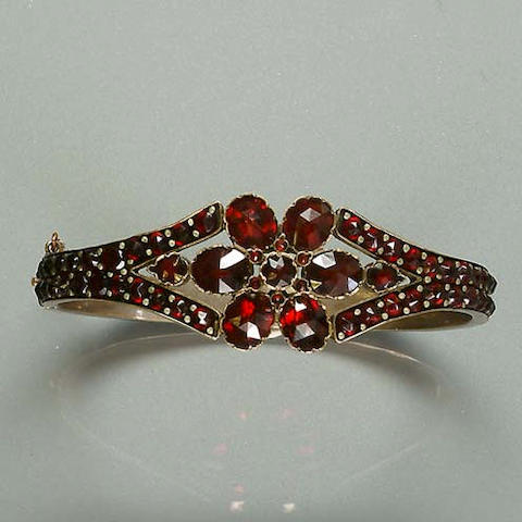 A 19th century bohemian garnet hinged bangle