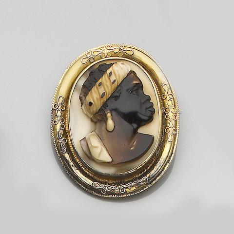 A mid 19th century operculum shell cameo brooch