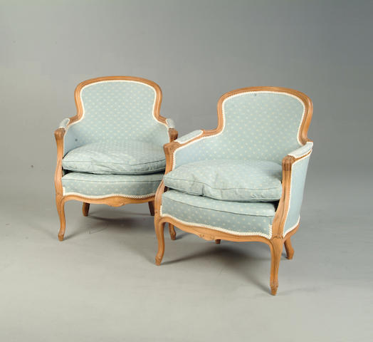 A pair of Louis XV style beech bergeres