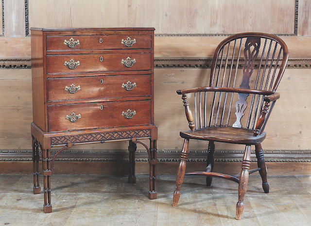 An early 19th Century yew and elm Windsor armchair