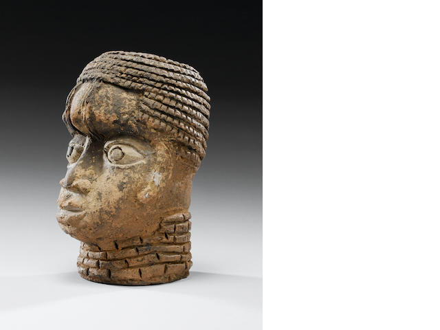 A Benin Terracotta Head 22cm. high