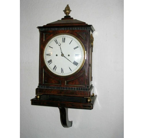 A Regency mahogany, part ebonised and brass mounted bracket clock; together with a matching bracket.