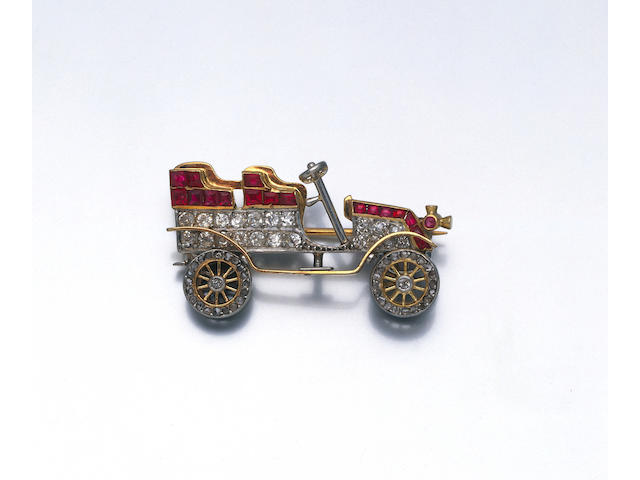A diamond and ruby motoring brooch, circa 1905,