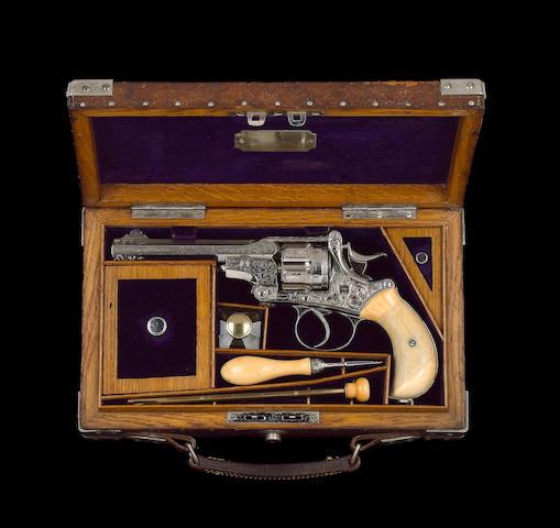 A FINE PRESENTATION WEBLEY KAUFMAN .455 (ELEY) DOUBLE-ACTION REVOLVER BY WEBLEY & SCOTT, NO.1178 In its oak framed crocodile hide case with ivory mounted accessories