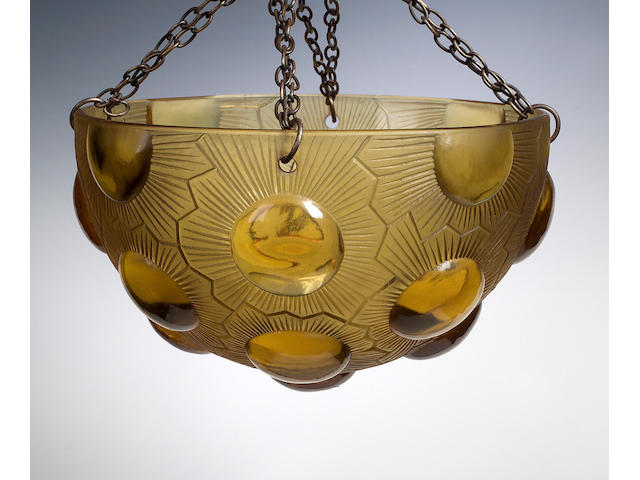 'Soleil', A pair of Rene Lalique amber glass plafoniers,