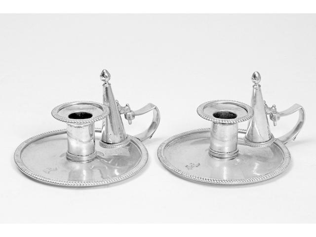 A pair of George III chambersticks, by Richard Cooke, London 1806,