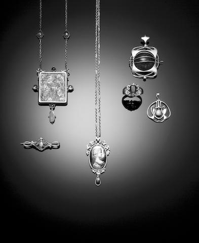 An Art Nouveau opal set bar brooch,