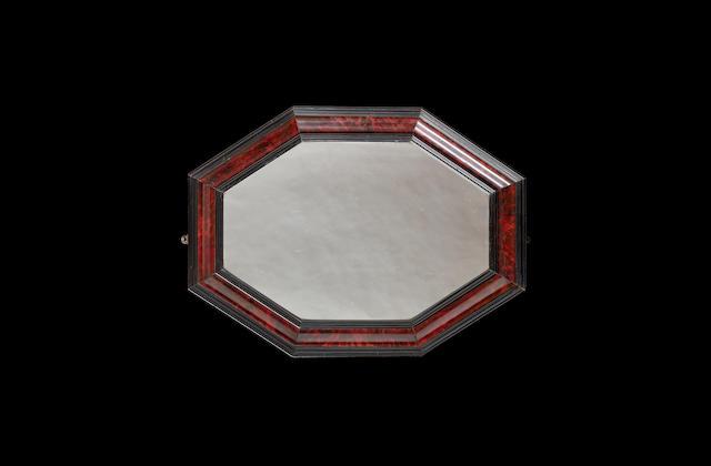A Flemish red tortoiseshell framed mirror