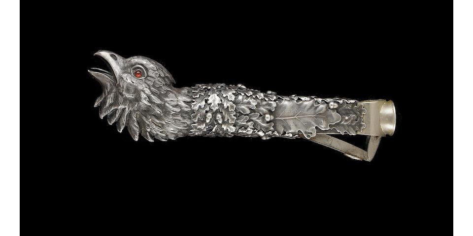AN EXCEPTIONAL RUSSIAN SILVER PHEASANT HEAD CIGAR CUTTER