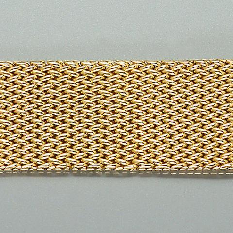 A wide articulated bracelet