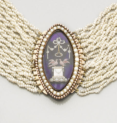 A seed pearl choker with an late 18th century memorial clasp