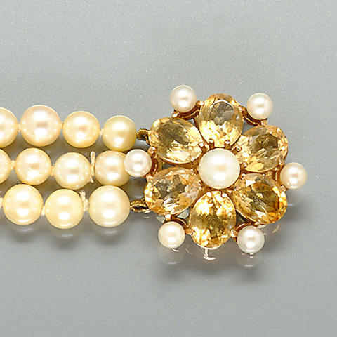 A cultured pearl bracelet with citrine clasp