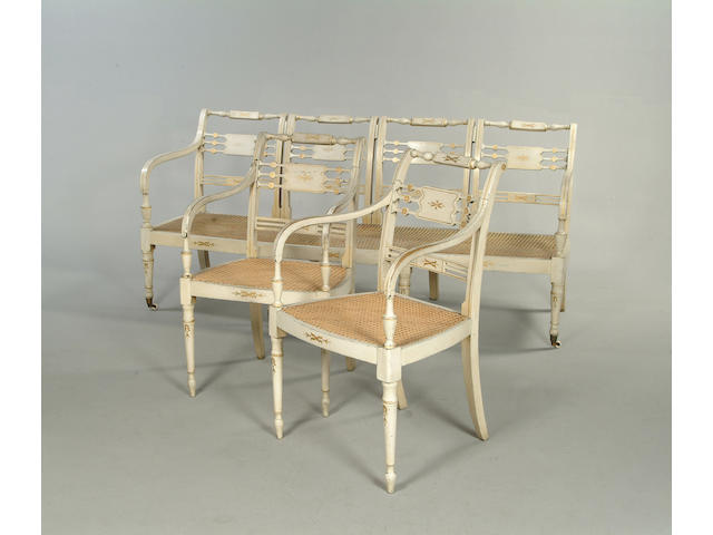 A set of eight Regency painted beech open armchairs