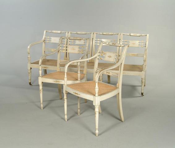 A set of eight Regency painted beech open armchairs