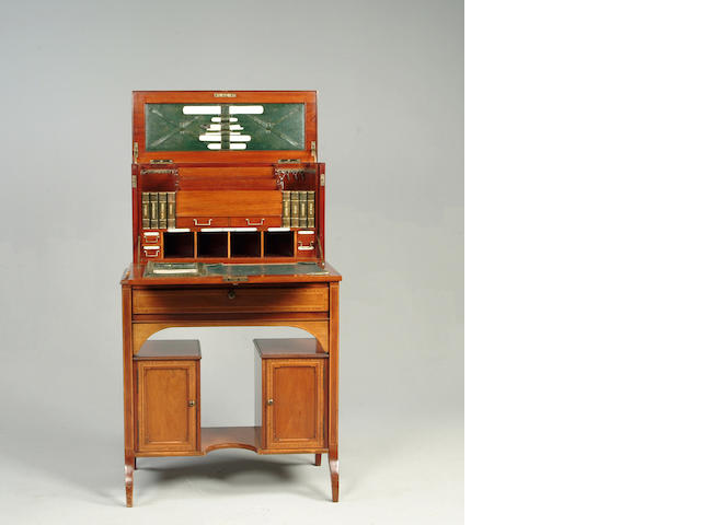 An Edwardian mahogany and tulip banded travelling ladies writing desk