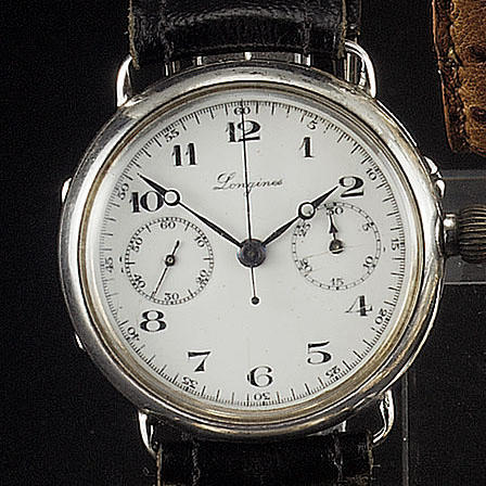 Longines. An early silver cased enamel dial single button chronograph wristwatch Movement No. and Ca