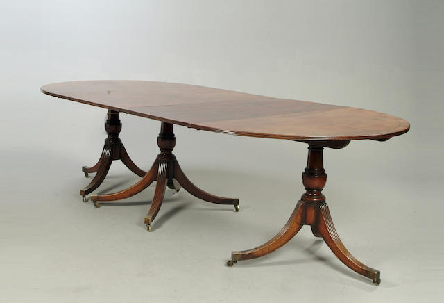 A George III style mahogany three pedestal dining table