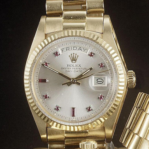 Rolex. An 18ct gold automatic bracelet watch with ruby set dial Ref:1803, 1980s