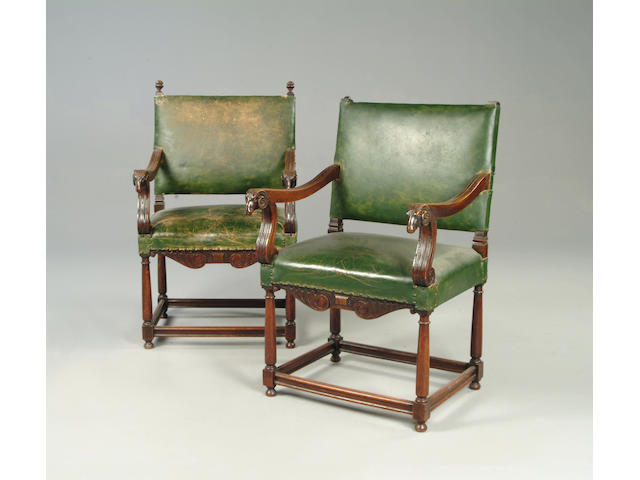 A pair of 17th century style leather upholstered hall chairs