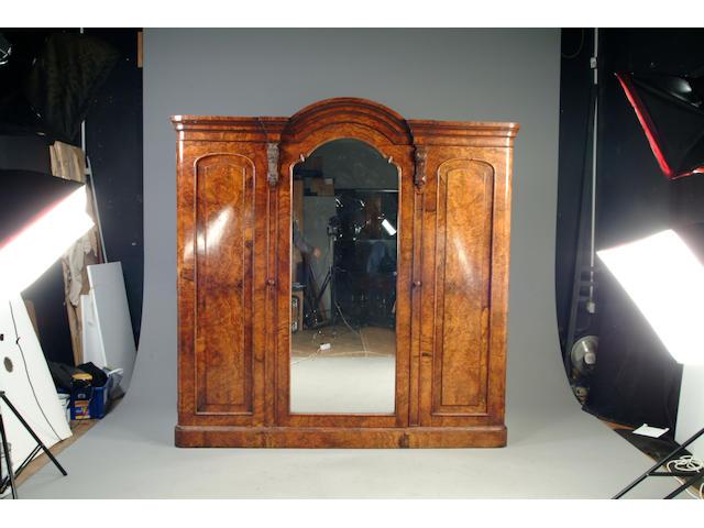 A Victorian walnut three section wardrobe