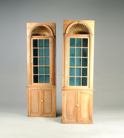 A pair of 19th century pine display cabinets
