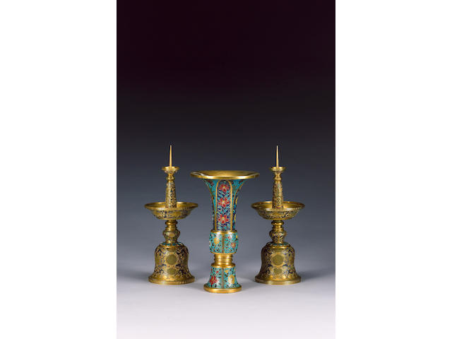 A cloisonne enamel gu-shaped beaker vase; and a pair of candlesticks;