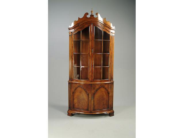 An 18th century style walnut corner display cabinet