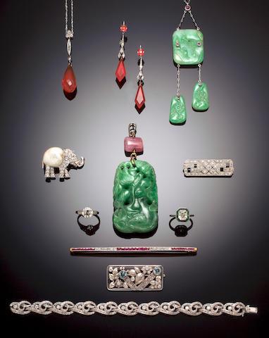 An art deco diamond and emerald ring