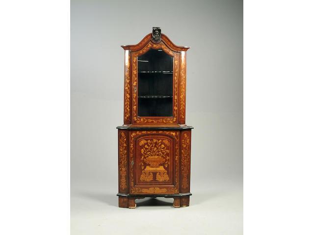 A Dutch marquetry standing corner cabinet