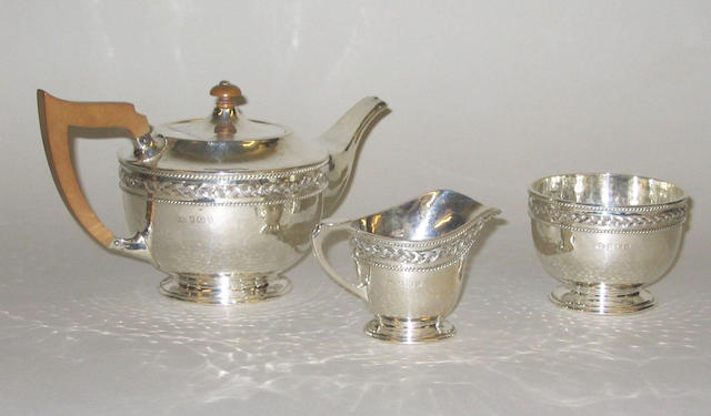 A three piece tea set, by A.E.Jones, Birmingham 1920,