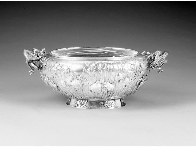 A Chinese silver two-handled oval bowl, impressed character mark in a rectangular punch and three further incuse character marks to the underneath,
