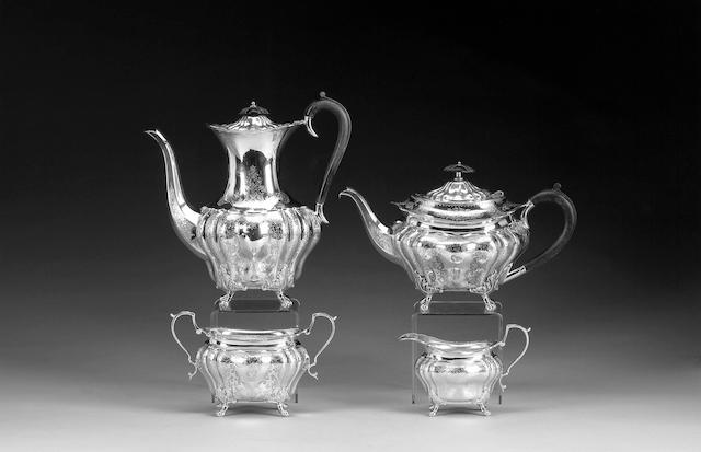 A Victorian four piece tea/coffee set of lobed oval form