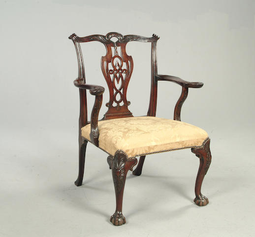 A late 19th / early 20th century carved mahogany armchair in the George III style